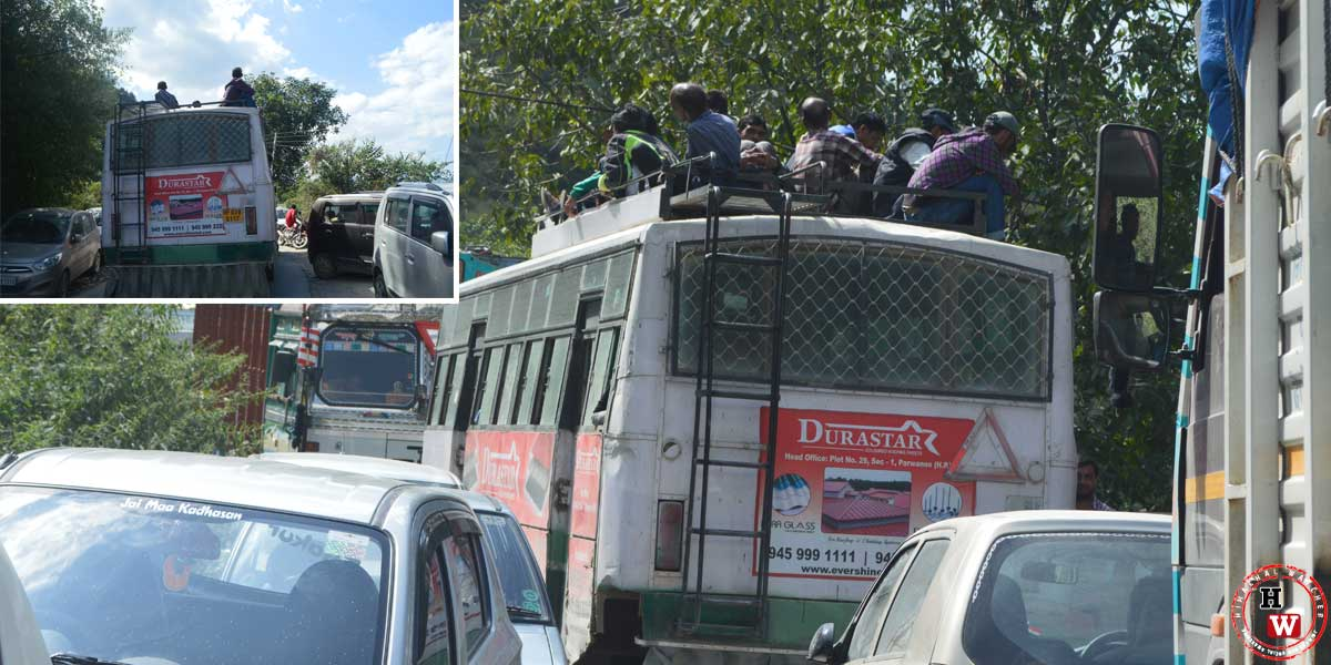 overloaded-hrtc-passangers-travelling-on-roof-of-bus-chopal-shimla
