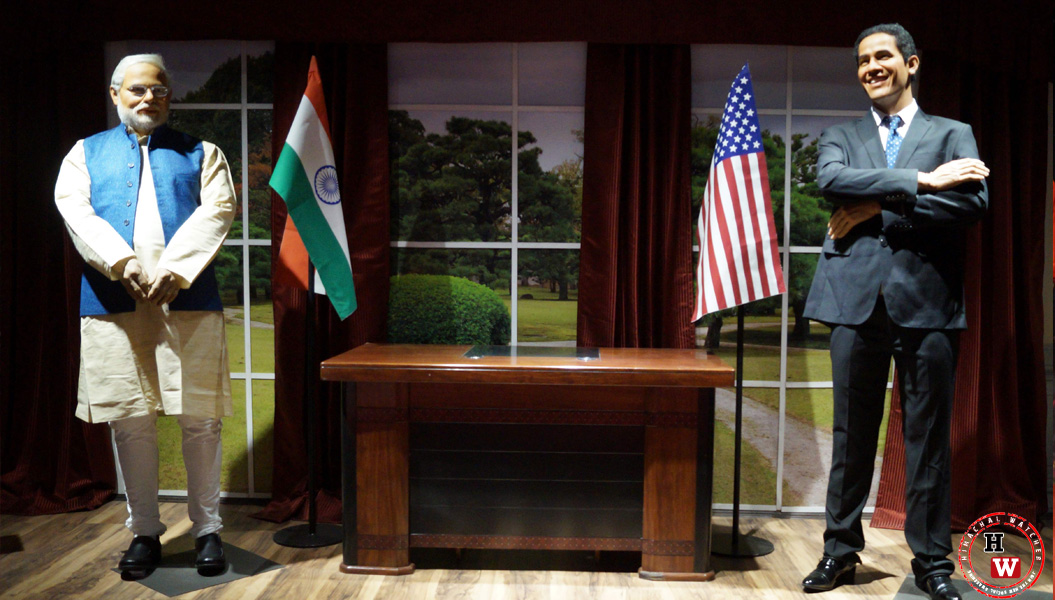 Indian Prime Minister standing face to face with Barrack Obama