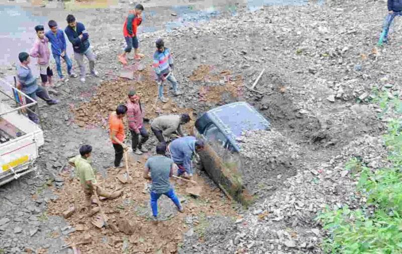 cars buried under Landslide