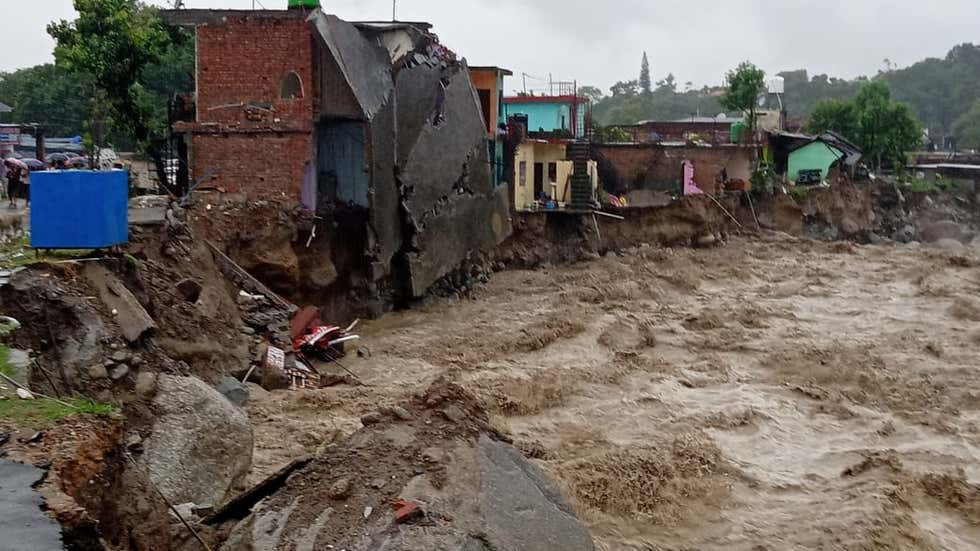 building swept away in dharamshala